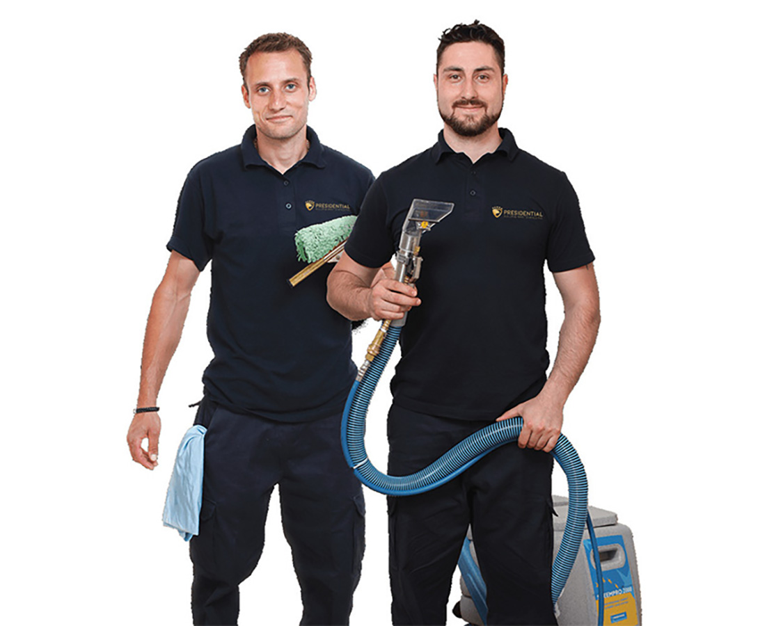 Picture of 2 Presidential employees with cleaning equipment