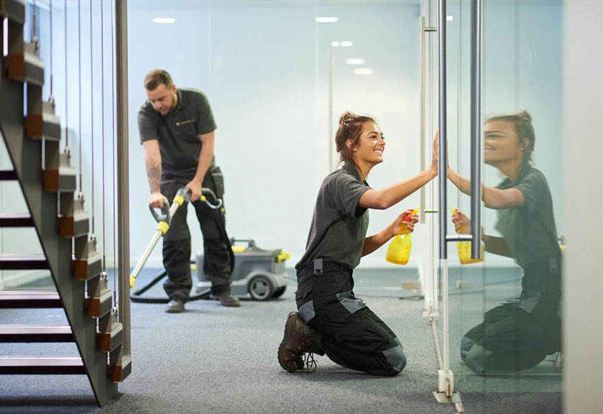 Employees commercially cleaning a property